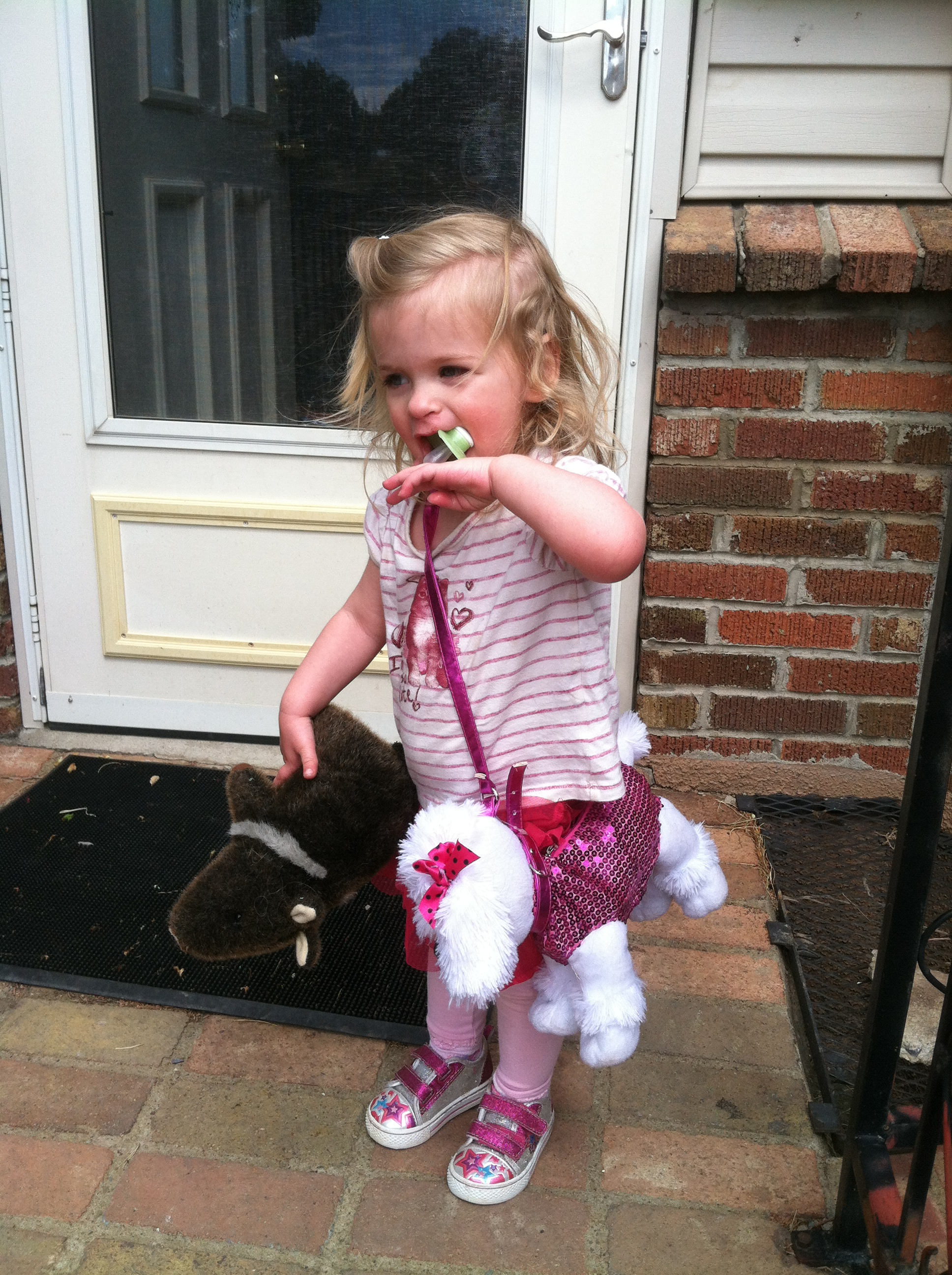 """Let's do this shopping thing."" Tiny-Small with her poodle purse AND her stuffed javalina (wild pig). That is one classy little girl!"